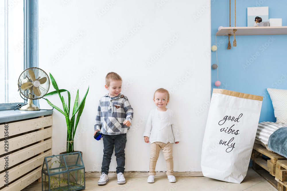 Fototapety, obrazy: Two happy siblings at home. Love and friendship between siblings concept