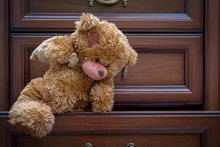 A Teddy Bear With A Bag Of Gifts Climbs Out Of The Dresser.