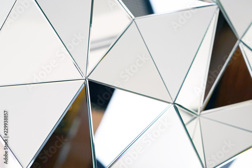 Obraz Mirror with crystals in wall, decoration and reflection. Abstract glass background. Polygonal surface. Close-up. Texture. - fototapety do salonu