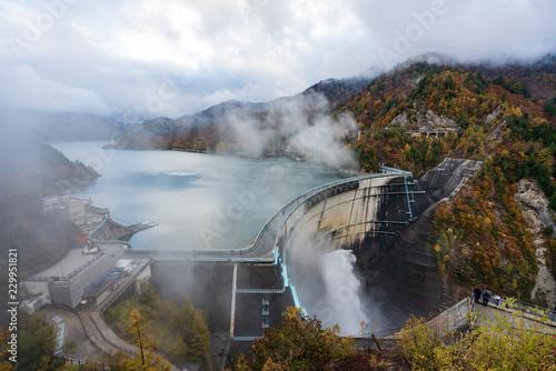 Poster Dam Landscape of Kurobe Dam in autumnal rain (秋雨の黒部ダム) in Toyama, Japan.