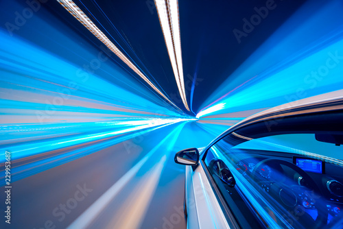 plakat Blue color tunnel car driving motion blur