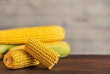 Fresh Corn On Cobs On Dark Wooden Table. With Copy Space
