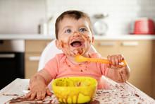 Happy Baby Eating Chocolate De...