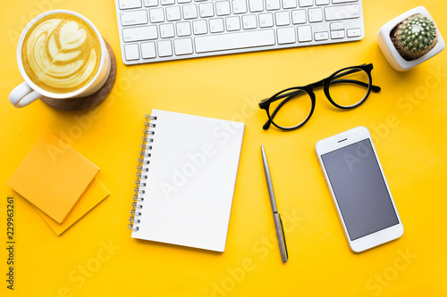 Fotografía Top view of office desk table with modern accessories,supplies on color background