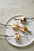 Summer Treat Of Toasted Marshmallows On Sticks