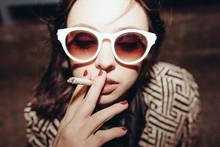 Young Fashonable Woman Smoking A Cigarette