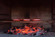 Meat Burgers Roasting On Barbecue Grill