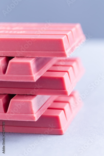 Foto auf Acrylglas Katze Finger Ruby Chocolate Bar made from ruby cocoa bean. New dimension of chocolate sweets.