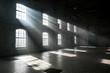 Leinwandbild Motiv Sunlight shining throuh the windows of an old abandoned industrial warehouse building