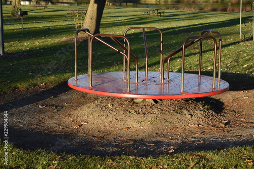 Empty merry go round at a playground in a park Canvas-taulu