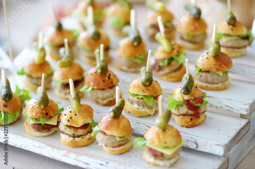 Tela Delicious one bite mini burgers served on a party or wedding reception
