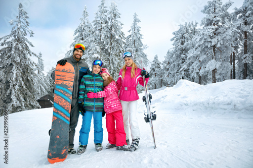 Happy family enjoying in winter vacations