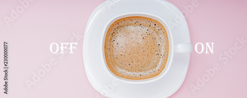 coffee in white cup with a lettering on and off on pink background, top view Wallpaper Mural