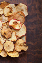 Slices Of Dried Apples On Wooden Table