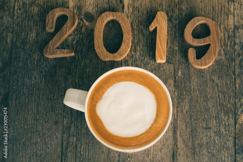 Foto op Plexiglas hot coffee with foam milk art 2019 on wooden table, latte art coffee