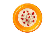 Top View Orange Bowl Of Semolina Sweet Porridge With Chia Seeds And Dried Berries Isolated At White Background. Concept Of Healthy Lifestyle.