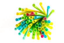 Multicolor And Colorful Plastic Drinking Straws On White Background. Abstract Background. Multicolor Background.