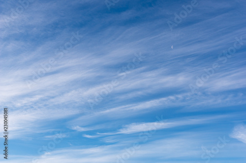 Hazy small cirrostratus, cirrocumulus and cumulus cloud formations at blue sky