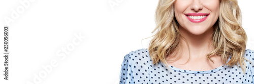 Obraz Beautiful young blond smiling woman with clean skin, natural make-up and perfect white teeth isolated over white background. Banner with copy space. - fototapety do salonu