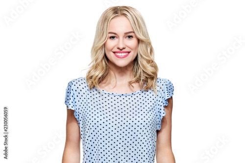 Fotografie, Obraz  Beautiful young blond smiling woman with clean skin, natural make-up and perfect white teeth isolated over white background
