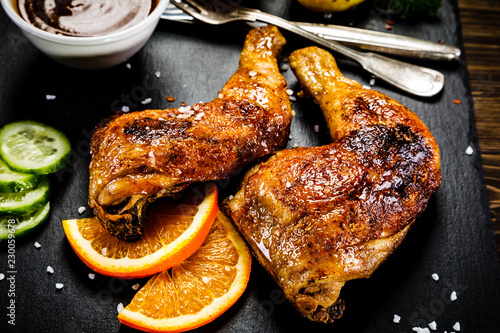 Grilled chicken legs with boiled potatoes and vegetables