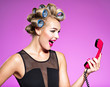 canvas print picture - Cheerful angry caucasian woman yelling at retro telephone.