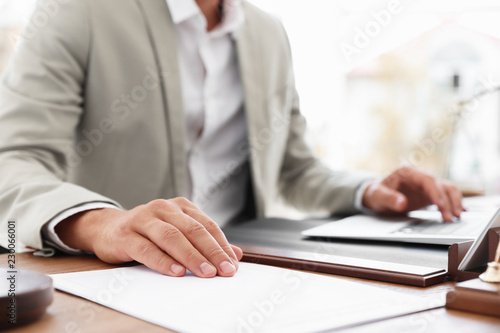 Male notary working with laptop at table in office, closeup Canvas Print