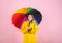 Woman With Rainbow Umbrella On...