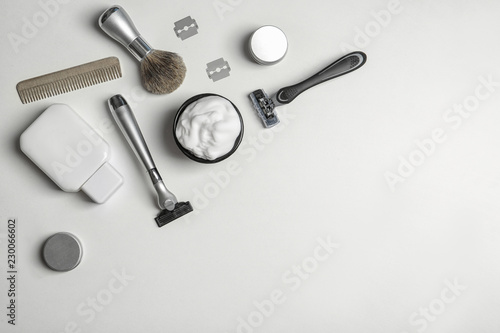 Flat lay composition with men's shaving accessories and space for text on white background