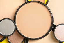 Various Shades Of Face Powder And Other Makeup Products As Background, Closeup