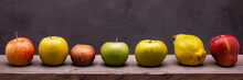 Panoramic Composition With Seven Different Types Of Apples