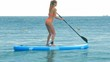 closeup lady trains to paddle SUP board on open ocean
