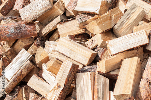 A pile of firewood from birch on the lawn Texture to Chop wood