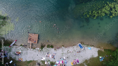Deurstickers Luchtfoto Aerial top view of people sunbathing swimming relaxing and jumping in lake