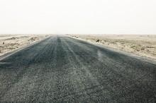 Straight Desert Road Leading T...