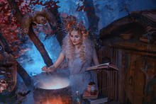 Atmospheric Cold Autumn Photo In Art Processing, A Good Witch Creates A Magic Elixir Near His Forest Home, Holding A Book In Her Hands, Dressed In An Old Gray Linen Dress And Has A Wreath On Her Head