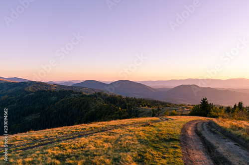Foto op Canvas Purper Sunset in the Carpathian Mountains in the autumn season