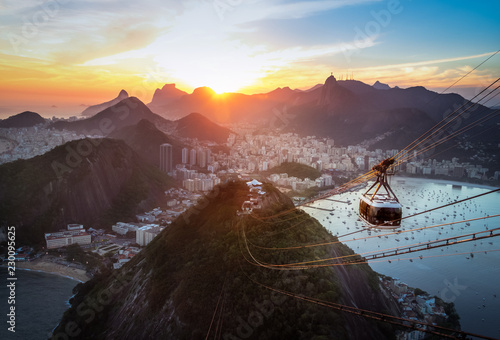 Aerial view of Rio de Janeiro at sunset with Urca and Sugar Loaf Cable Car and Corcovado mountain - Rio de Janeiro, Brazil