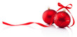 canvas print picture - Two red Christmas decoration baubles with ribbon bow isolated on white background