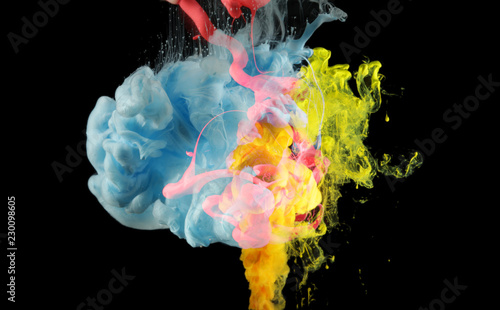 Acrylic colors in water. Ink blot. Abstract background on black.