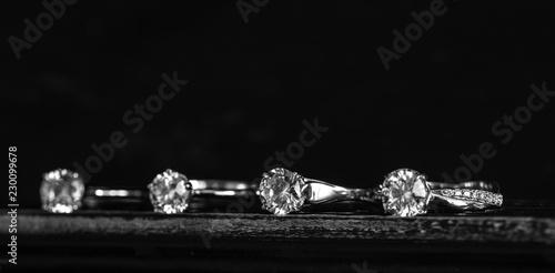 Valokuva  Diamond Rings on Black Background