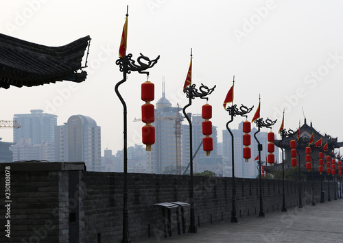 Photo Stands Shanghai Fortifications of Xian (Sian, Xi'an) an ancient capital of China-- represent one of the oldest and best preserved Chinese city walls