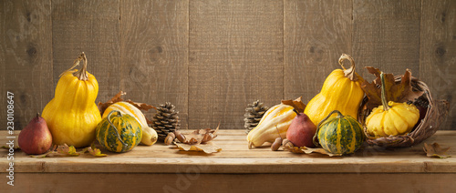 Poster Pays d Asie Autumn harvest background with pumpkin and squash on wooden table