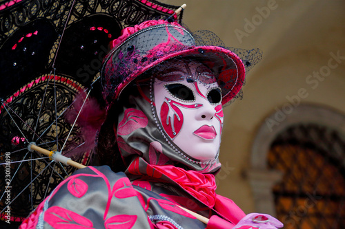 Fototapety, obrazy: Colorful carnival pink-grey mask and costume at the traditional festival in Venice, Italy