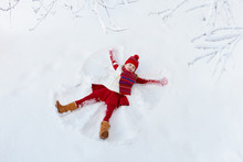 Child Making Snow Angel. Kids ...