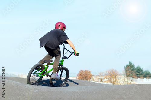 Boy in bike helmet on bmx track Canvas Print