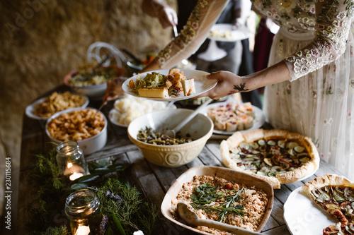 Fotografie, Obraz  People eating fresh vegan food