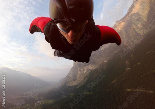 Fotografie, Obraz  BASE Jumper Self Portrait. Wingsuit flight