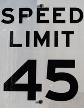 Speed Limit 45, Close Up Of A Black And White Street Sign. Symbol Of Limit And Order