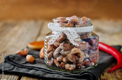 Honey red pepper roasted cashews in a glass